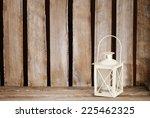 White Lantern On Wooden Table