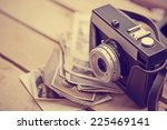 old retro camera on vintage... | Shutterstock . vector #225469141