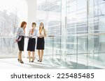 happy businesswomen standing... | Shutterstock . vector #225485485