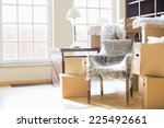 moving boxes and furniture in... | Shutterstock . vector #225492661