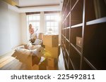 woman unpacking lamp from... | Shutterstock . vector #225492811