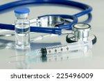 syringe  vial and stethoscope... | Shutterstock . vector #225496009