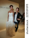 Small photo of NEW YORK, NY - OCTOBER 09: Designer Della Giovanna (R) with model at the Della Giovanna Bridal Runway Show during Fall 2015 Bridal Collection at the Alchemical on October 09, 2014 in New York City.