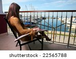 young woman sitting on balcony... | Shutterstock . vector #22565788