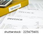 binder of tax invoice documents ... | Shutterstock . vector #225675601