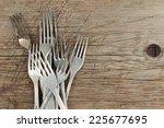 pile of retro aluminum forks on ... | Shutterstock . vector #225677695