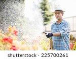 Man Watering Plants Outside...