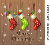 christmas stocking and presents | Shutterstock .eps vector #225752665