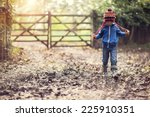Boy Walking On Muddy Footpath...