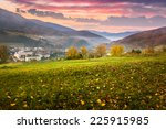 autumn landscape. village on the hillside. forest in fog on mountains at sunrise - stock photo