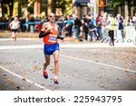 Small photo of NEW YORK - NOVEMBER 3: Chema Martinez of Spain running the 2013 NYC Marathon for Professional Men category on November 3, 2013 in New York.