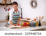 young woman reading cookbook in ... | Shutterstock . vector #225948724