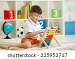 kid boy playing with abacus... | Shutterstock . vector #225952717