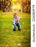 happy kids blow bubbles outdoors | Shutterstock . vector #226083979