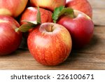 Ripe red apples on wooden...