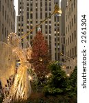 An angel decoration and colorful lights frame the Christmas tree at Rockefeller Center in Manhattan. - stock photo
