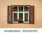 window with shutters and flower | Shutterstock . vector #226141531