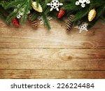 Christmas Fir Tree On Wooden...