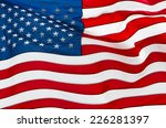 us flag in rippling with wind  | Shutterstock . vector #226281397