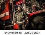 Cheerful Firefighter Near Truc...