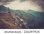 woman hiker on a top of a... | Shutterstock . vector #226297924
