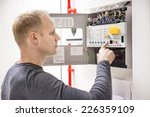 Technician Checks Fire Panel I...