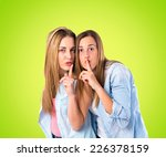 friends making silence gesture... | Shutterstock . vector #226378159