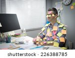 busy white collar sitting at... | Shutterstock . vector #226388785
