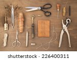 leather craft tools on a wooden ... | Shutterstock . vector #226400311