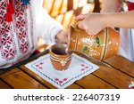 bride pouring milk for her... | Shutterstock . vector #226407319