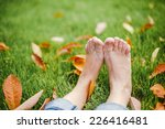Bare Feet On Green Grass With...