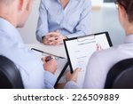 two employers checking... | Shutterstock . vector #226509889