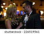 a man and a woman holding a... | Shutterstock . vector #226519561