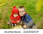 brother and sister on the fall... | Shutterstock . vector #226546519