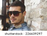 portrait of young man with... | Shutterstock . vector #226639297