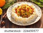 rice with fish in orange sauce...   Shutterstock . vector #226650577