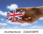 hand holding small flag of ... | Shutterstock . vector #226653895
