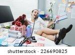 female office worker feet up on ... | Shutterstock . vector #226690825