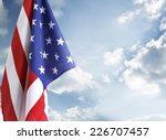 american flag in blue sky | Shutterstock . vector #226707457
