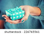 close up of female hand holding ... | Shutterstock . vector #226765561