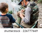 man and his grandson fishing | Shutterstock . vector #226777669