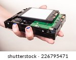 hand with hard drives | Shutterstock . vector #226795471