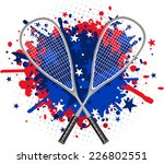 squash rackets with red and