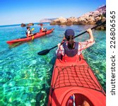 woman kayaking on the sea with... | Shutterstock . vector #226806565