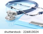 stethoscope on light blue... | Shutterstock . vector #226813024