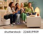 four friends having dinner at... | Shutterstock . vector #226819909