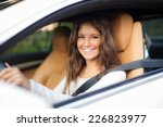 young woman driving her car | Shutterstock . vector #226823977