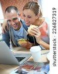 roommates eating sandwich in... | Shutterstock . vector #226827319