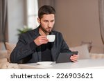 man with tablet in cafe | Shutterstock . vector #226903621