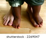 two pairs of feet belonging to... | Shutterstock . vector #2269047
